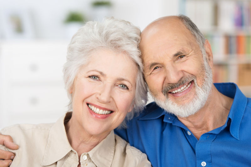 Older couple smiling | dental implants Lexington ma