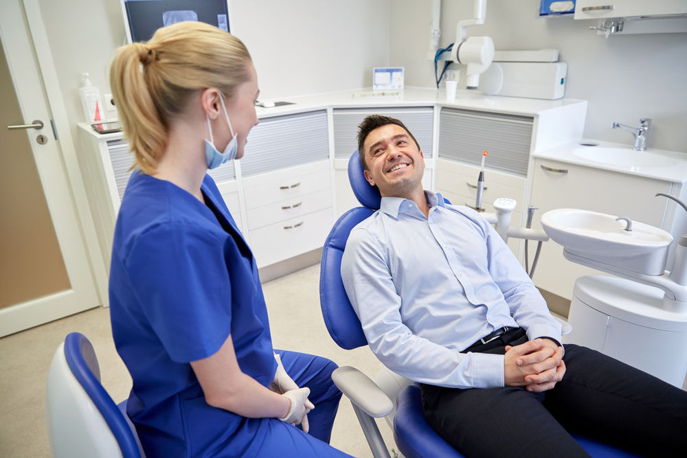 dentists in Lexington MA | dentist with patient