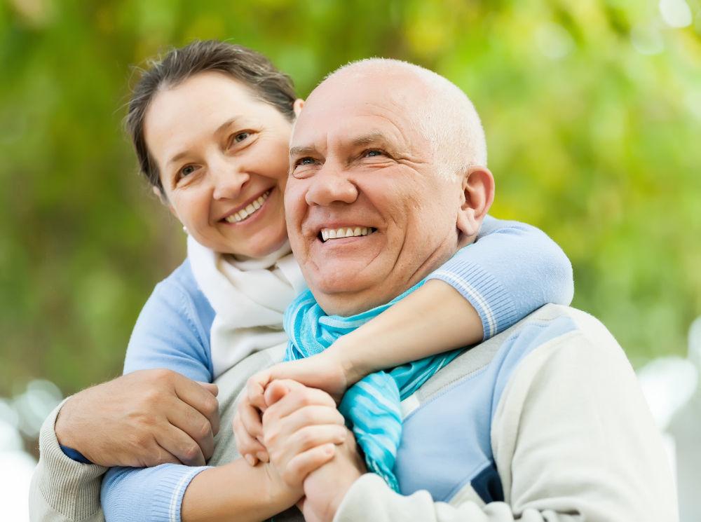 dental implants in Lexington MA | Elderly couple smiling.